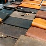 Man's Leather handmade wallets on the counter, background, pattern